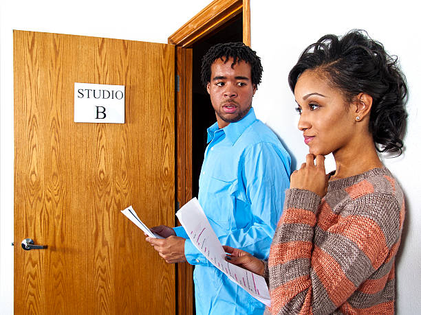 actors waiting in line at a casting session audition - audition stock photos and pictures
