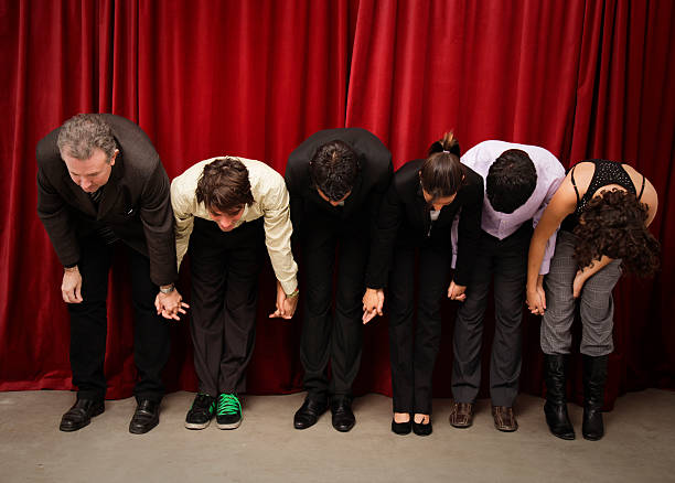 Actos saluting to the audiencie stock photo