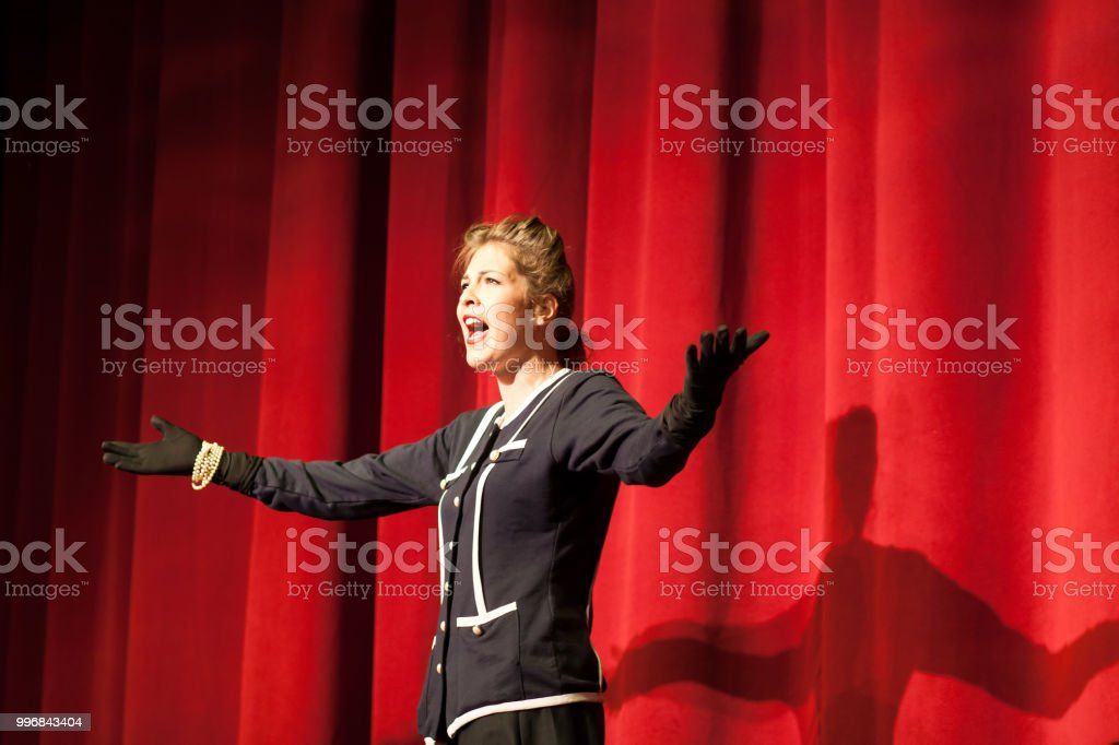 actress acting on stage stock photo