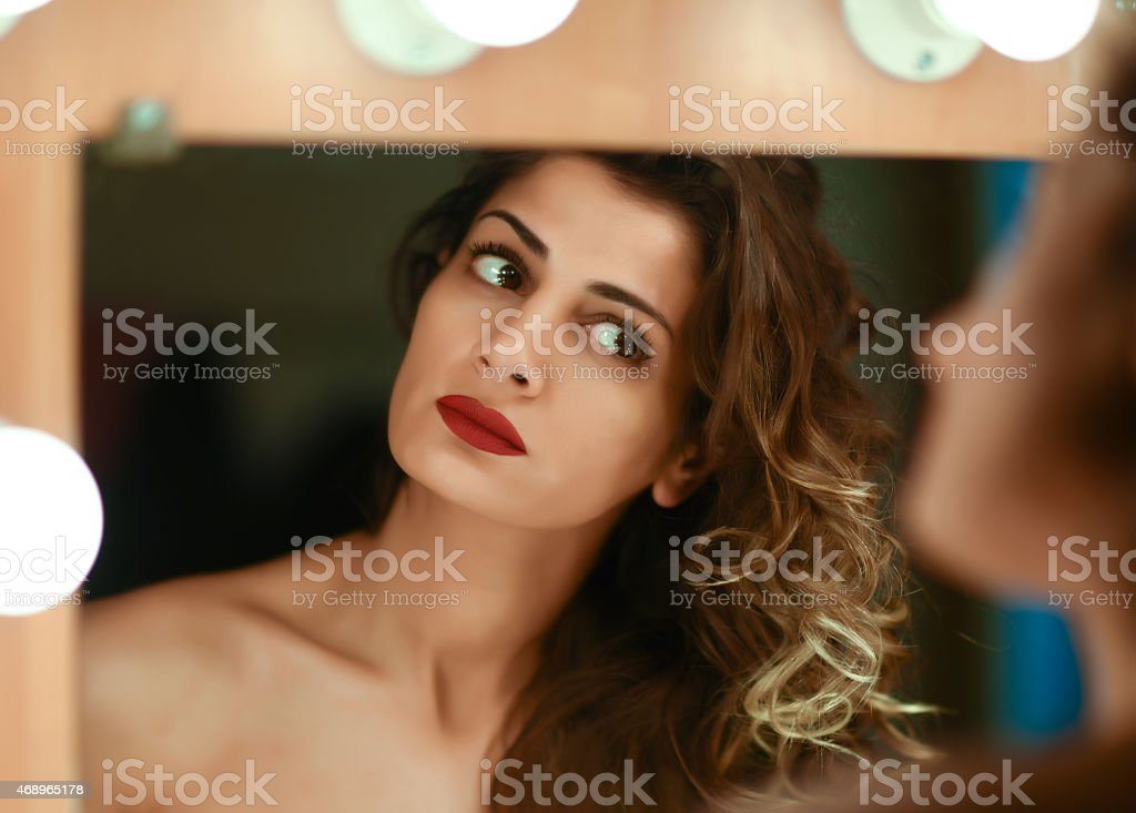 Actress Applies Makeup Backstage stock photo
