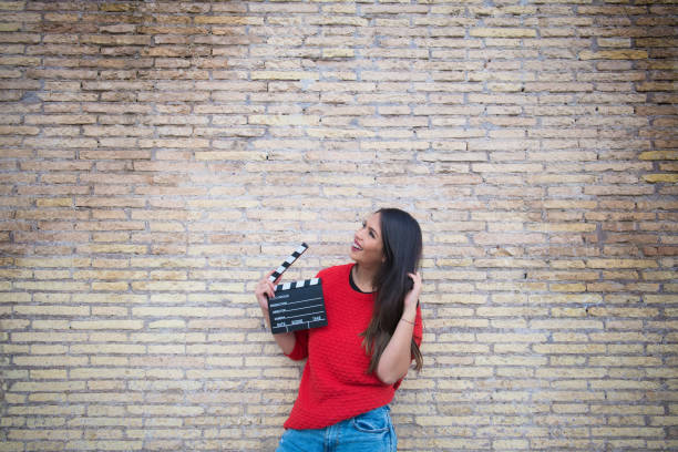 actress audition outdoor with clapperboard - audition stock photos and pictures