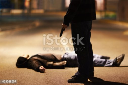 Man lying on the ground after being shot by a gun-wielding criminal
