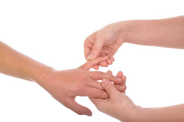 Acupressure - Fingers massage stock photo