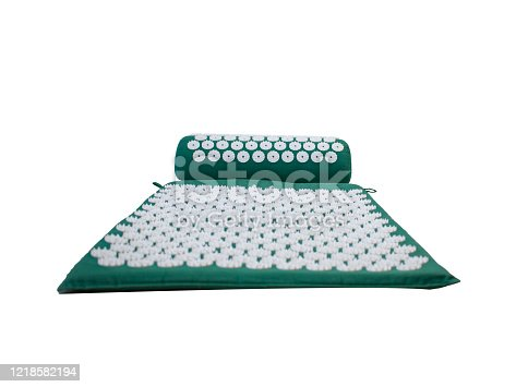 istock Acupuncture massager-applicator mat and roller under the head, neck magnets for intense exposure. Needle Kuznetsov applicator isolated on a white background. 1218582194