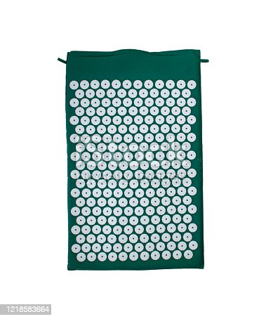 istock Acupuncture massager-applicator mat under the head, neck magnets for intense exposure. Needle Kuznetsov applicator isolated on a white background. 1218583664