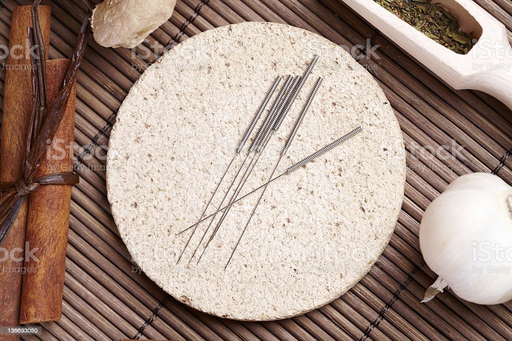 Acupuncture needles and TCM herbs royalty-free stock photo