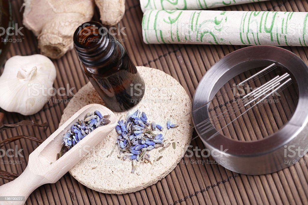 Acupuncture needles, moxa sticks and TCM herbs stock photo