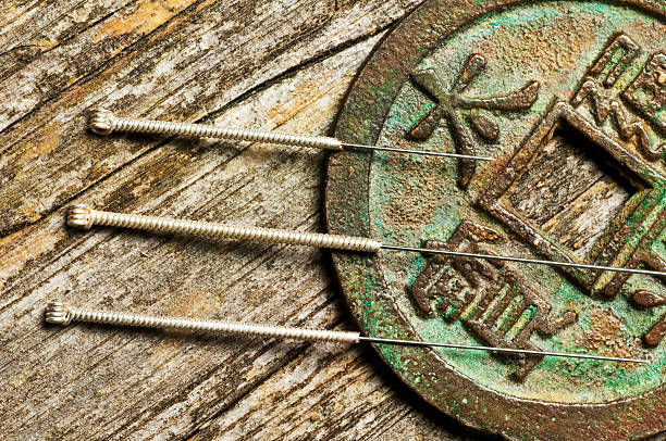 acupuncture needles - acupuncture stock photos and pictures