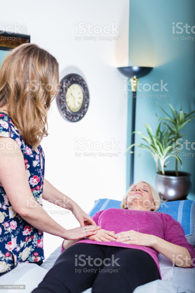 Acupuncture Therapist Practitioner At Wellness Center