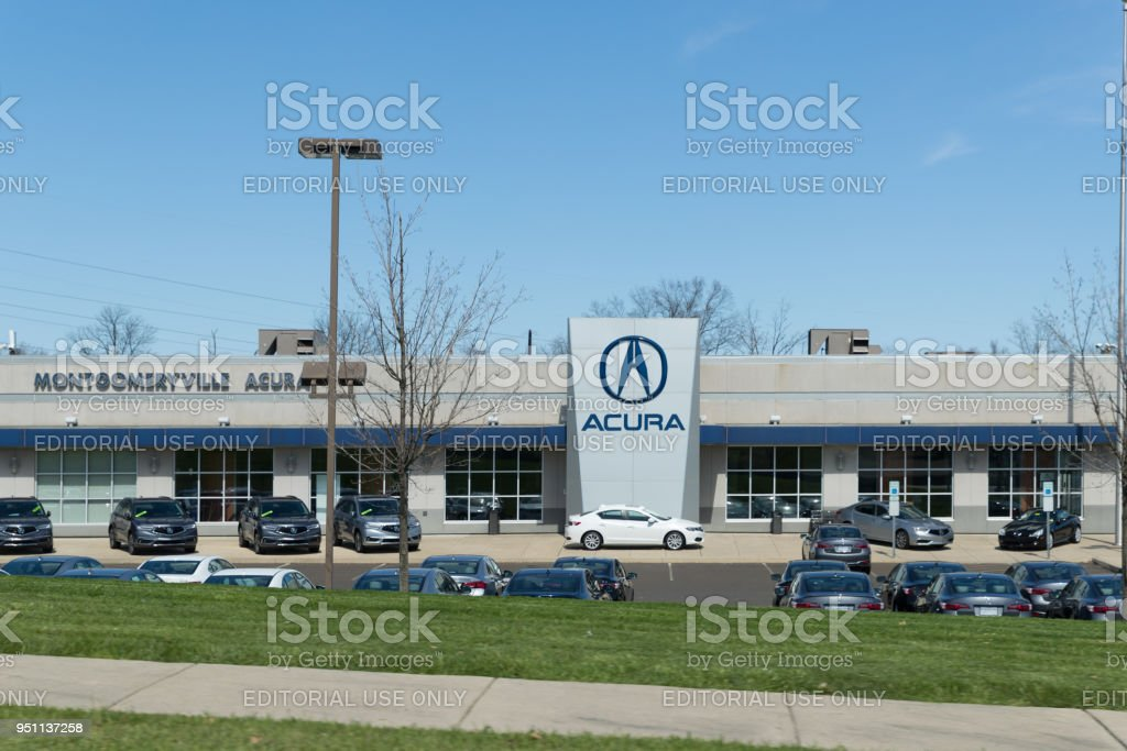 Acura automobile dealership sign and logo. stock photo