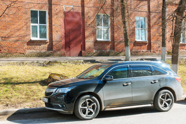 Acura MDX (Honda MDX) parked on the  street of Smolensk City. stock photo