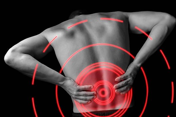 dor nas costas dor aguda, área de cor vermelha - parte inferior - fotografias e filmes do acervo