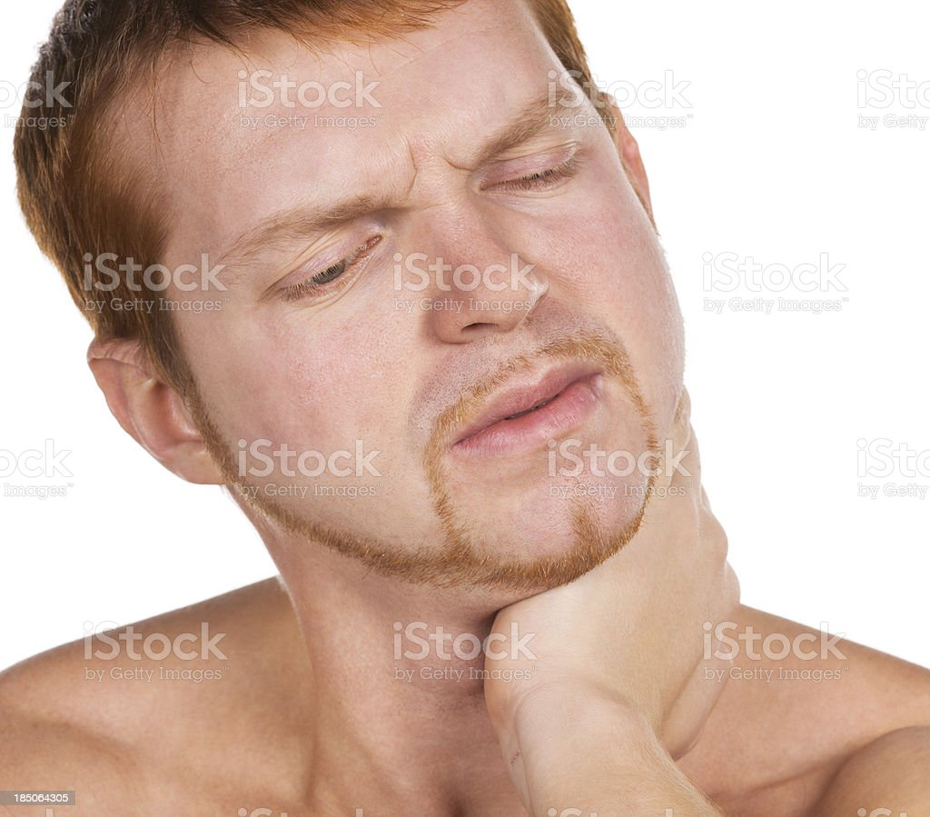 Acute pain in a neck at the young man royalty-free stock photo