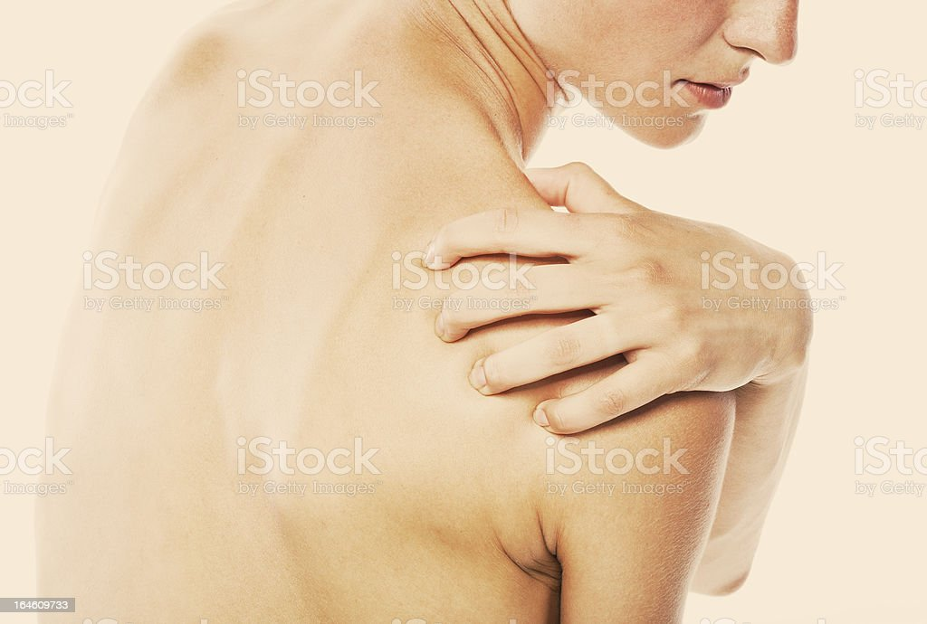 Acute pain in a shoulder at the young women. royalty-free stock photo