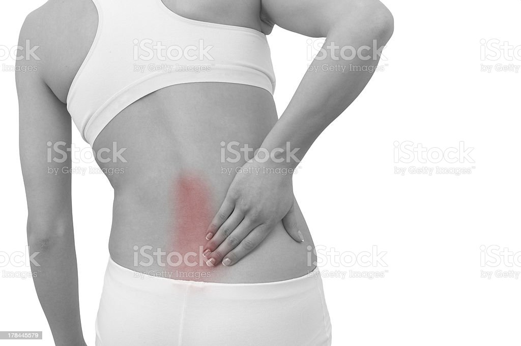 Acute pain in a woman back. royalty-free stock photo