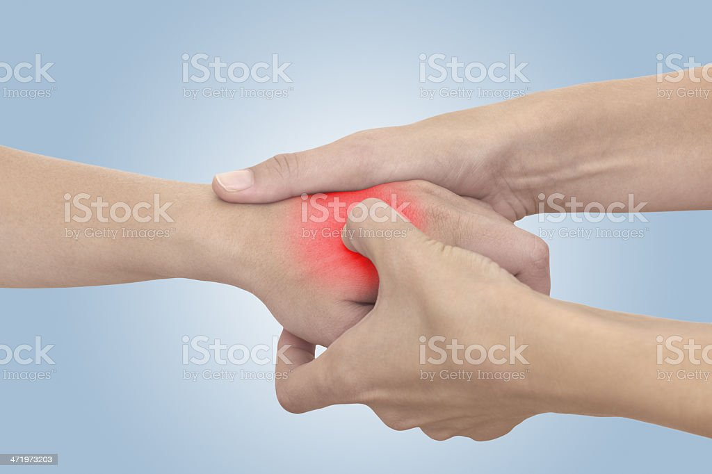 Acute pain in a woman palm stock photo
