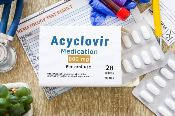 "Acyclovir medication as international nonproprietary or generic name concept photo. Packaging of drugs labeled ""Acyclovir medication"" is on doctor table with stethoscope Acyclovir medication as international nonproprietary or generic name concept photo. Packaging of drugs labeled ""Acyclovir medication"" is on doctor table with stethoscope antiviral drug stock pictures, royalty-free photos & images"