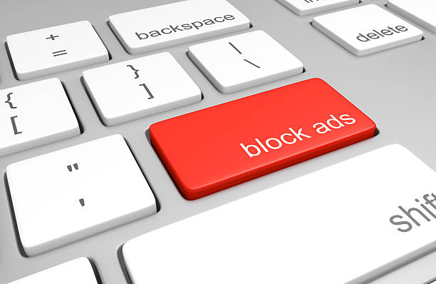Ad blocking key on computer keyboard for stopping internet advertising stock photo