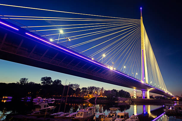 Ada Bridge at night, Belgrade, Serbia Ada Bridge (Most na Adi) a 969 m long and 200 m tall pylon bridge with six-lane roadway and unlaid double-track mass transit right-of-way is opened in 2012. serbia stock pictures, royalty-free photos & images
