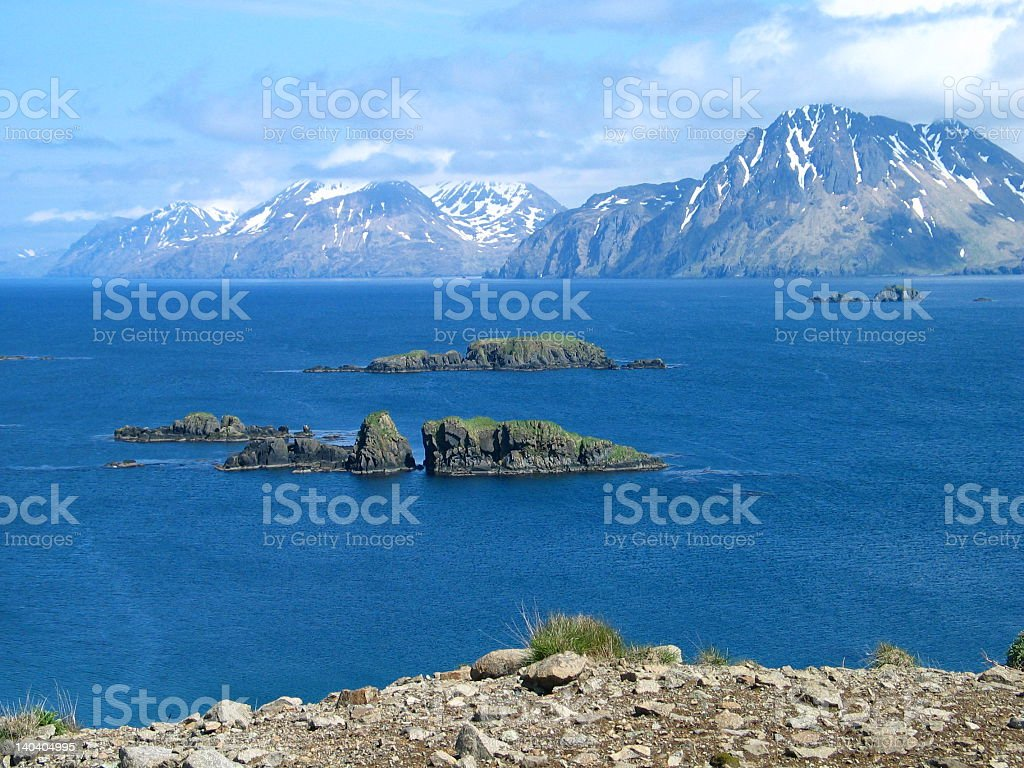 Adak Island with mountains in the background stock photo