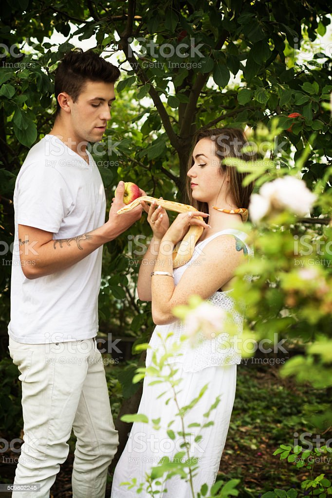 Vertical outdoor garden shot of two young people in white. Concept of...