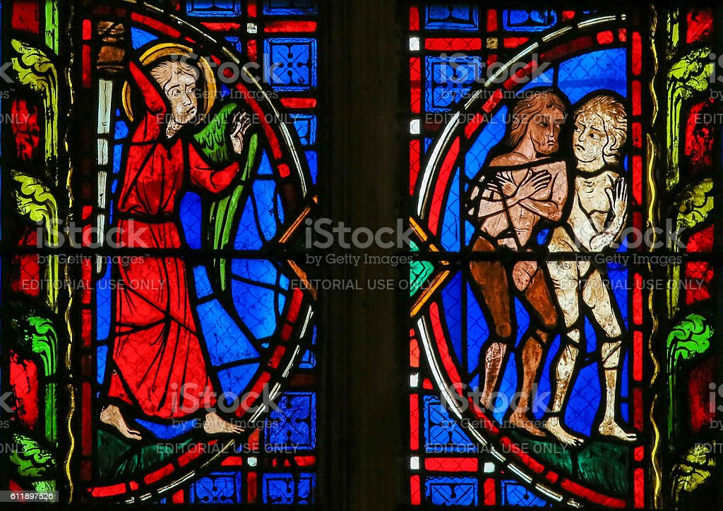 Adam and Eve - Stained Glass in Tours Cathedral stock photo
