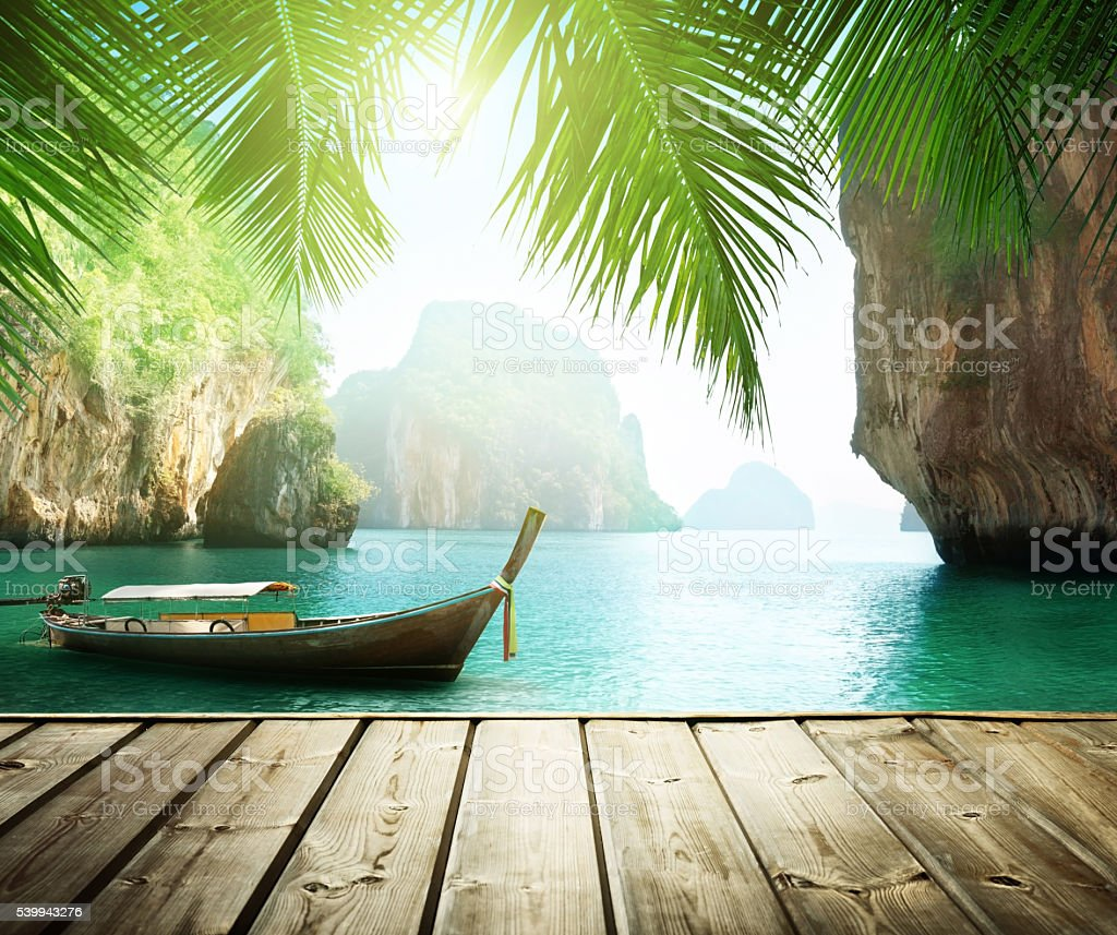 Adaman sea and wooden boat in Thailand stock photo