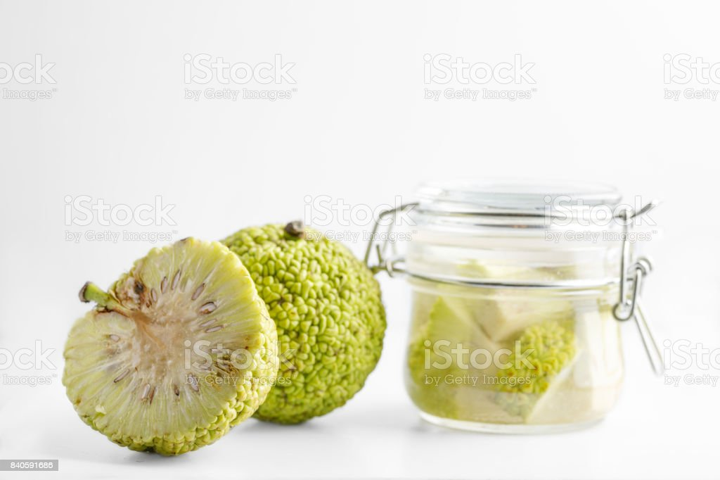 Adam's apple isolated on white background. Tincture of Adam's apple in a glass jar. stock photo