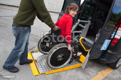 Man helping wheelchair user