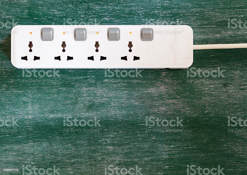 Adapter power plug with chalkboard background stock photo