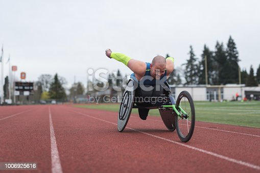 istock Adaptive athlete training on his racing wheelchair 1006925616