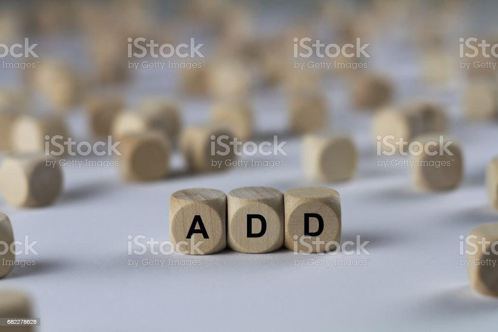 add - cube with letters, sign with wooden cubes stock photo