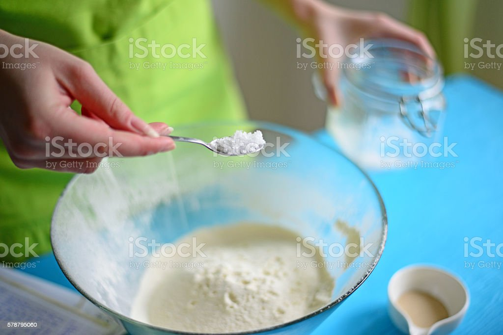Add salt in flour stock photo