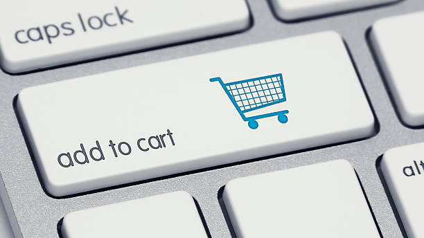Add to Cart Keyboard Button with Blue Shopping Cart stock photo