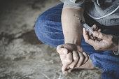 istock Addict hands making syringe injection of heroin, Concept of drug use, World Anti-Drug Day 1146220111