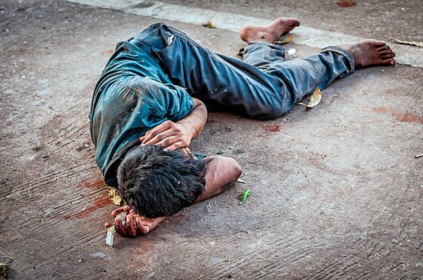 Addict man sleeping on the street, Jaipur stock photo