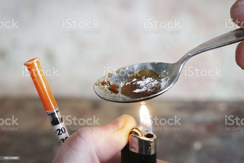 Addict preparing drugs stock photo