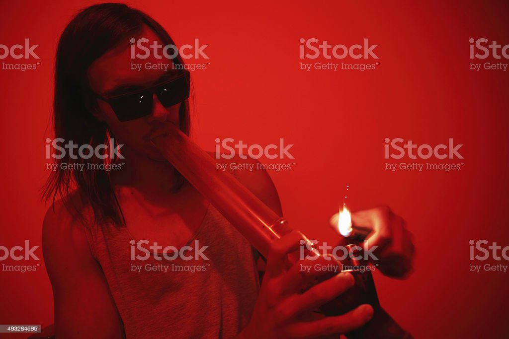 Addict smokes marijuana stock photo