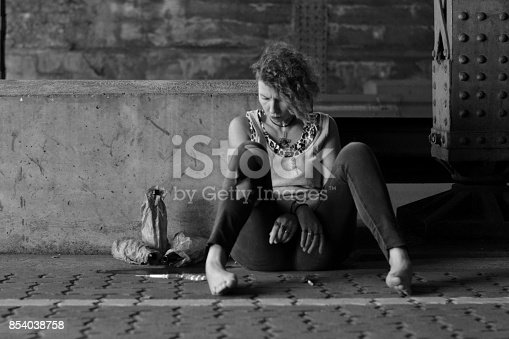 istock addicted hopeless punk woman with drugs 854038758