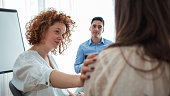 istock Addicted people comforting woman at psychotherapy session 1212152795