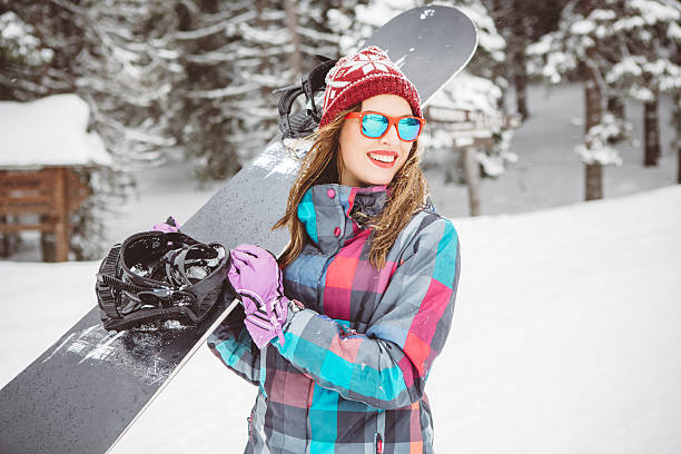 addicted to snowboarding - winterjacke lang damen stock-fotos und bilder