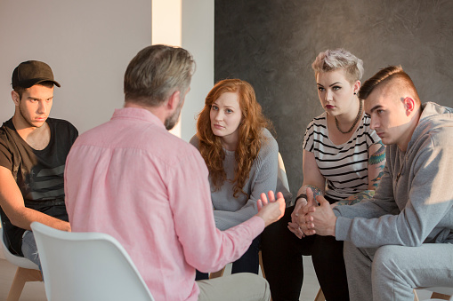 istock Addiction counselor and his patients 691775770