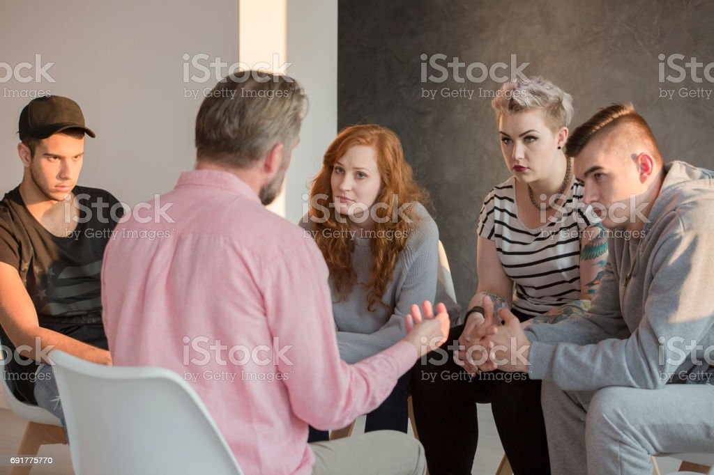 Addiction counselor and his patients stock photo