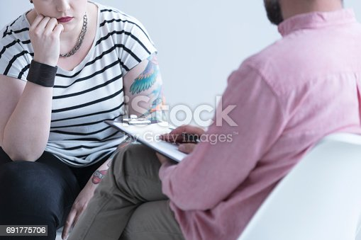618070568 istock photo Addiction counselor talking with girl 691775706
