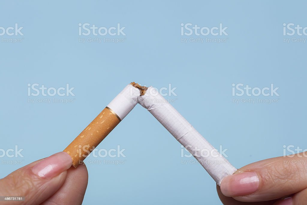Addiction. Hands breaking cigarette. Quit smoking. royalty-free stock photo