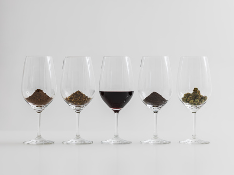 istock Addictions Coffee, Chocolate, Cannabis, Tobacco in wineglasses 636328476