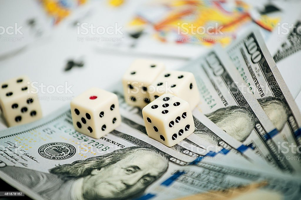 Addictive gambling with dice and poker cards in casino stock photo