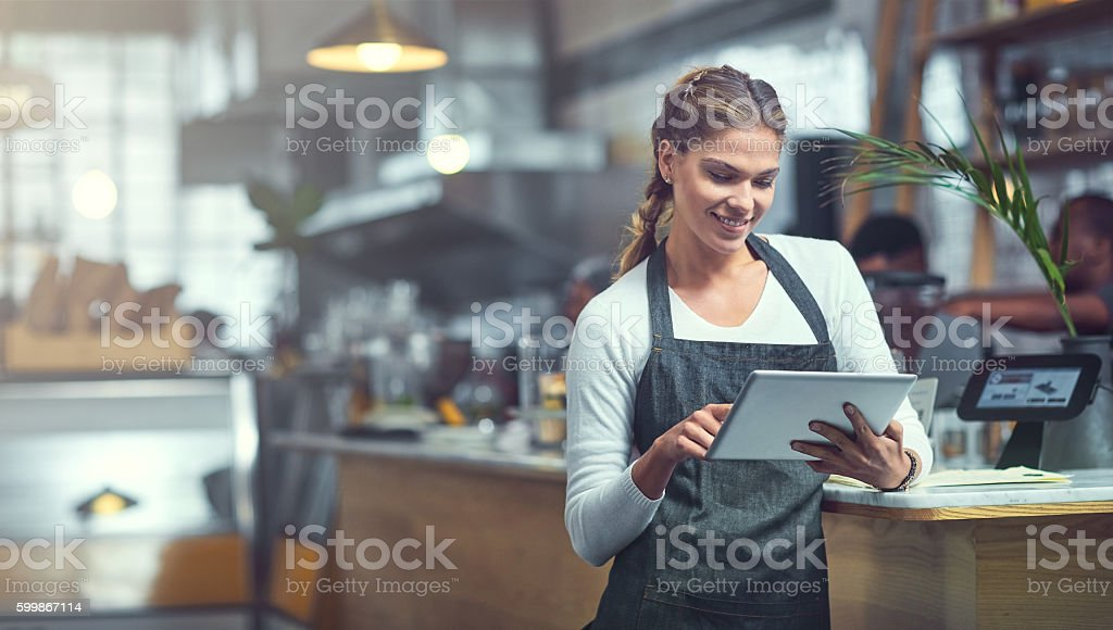 Adding a customer survey to her store's website stock photo