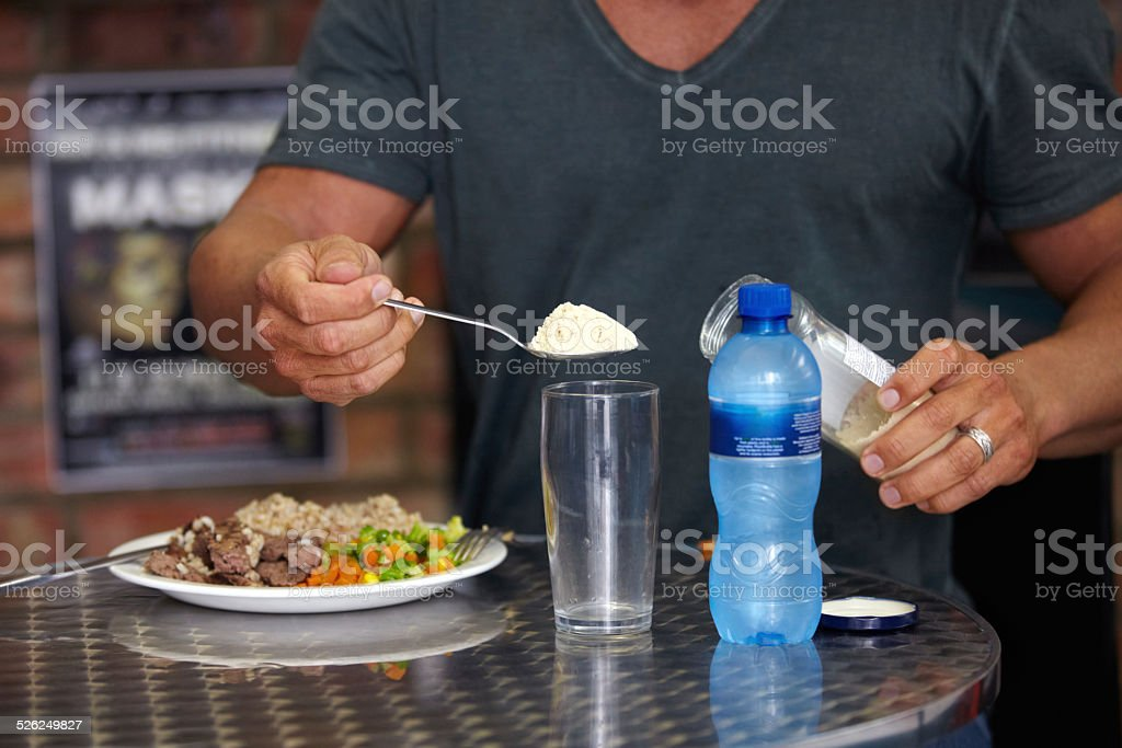 Adding a little help to his meal stock photo