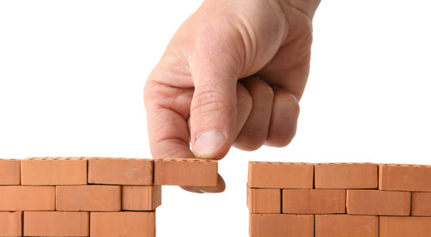 adding brick to a gap in the wall stock photo